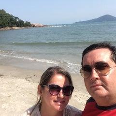 Photo taken at Praia das Conchas by Gina Paula Correa A. on 10/10/2014