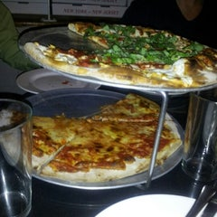 Photo taken at John's Pizzeria by Prasad N. on 1/9/2013