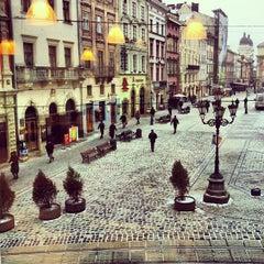 Photo taken at Площа Ринок / Rynok Square by Pavlo H. on 1/18/2013