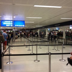 Photo taken at Security/Passport Control - T1 by Richard on 8/26/2013