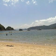 Photo taken at South Bay Beach 南灣泳灘 by Doron V. on 6/1/2013