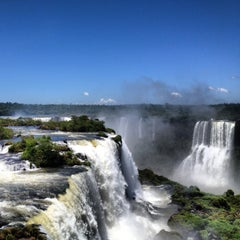 Photo taken at Cataratas del Iguazú by Ilya U. on 12/25/2012