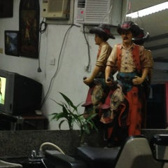 Photo taken at Cowboy Barber Shop by Oliver G. on 9/15/2013