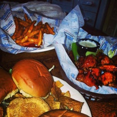 Photo taken at Bikinis Sports Bar & Grill by Humberto R. on 4/25/2013