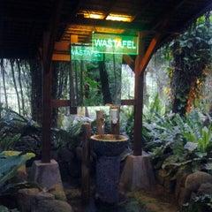 Photo taken at Kampung Daun Culture Gallery & Cafe by Kenji M. on 2/8/2013