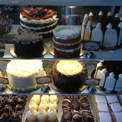 Photo taken at Mad Hatter Bakeshop & Café by Chuck N. on 8/30/2013