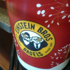 Photo taken at Einstein Bros Bagels by Cristina B. on 12/8/2012