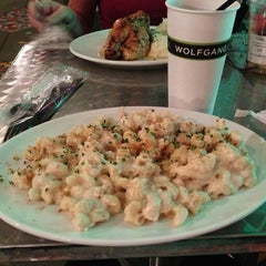 Photo taken at Wolfgang Puck Express (West Side) by Lindsey W. on 1/6/2013