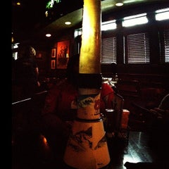 Photo taken at Tilted Kilt Pub & Eatery by Antoine L. on 12/16/2012