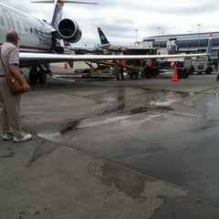 Photo taken at Gate E5 by James P. on 6/2/2013