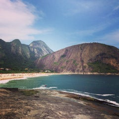 Photo taken at Praia de Itacoatiara by Roberta S. on 2/9/2013