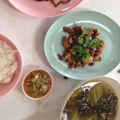Photo taken at ข้าวต้มปฐม by N S. on 9/4/2014