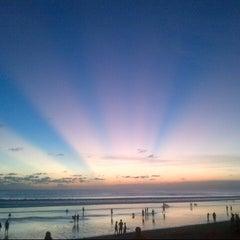 Photo taken at Pantai Kuta (Kuta Beach) by Michael M M. on 6/26/2013