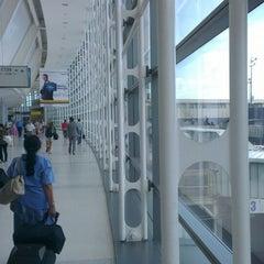 Photo taken at Newark Liberty International Airport (EWR) by Sinan A. on 7/15/2013