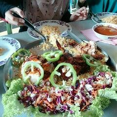 Photo taken at Maza Jungle Food Court by KIKI S. on 5/7/2015