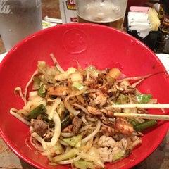 Photo taken at Genghis Grill by Muneyoshi U. on 12/3/2012