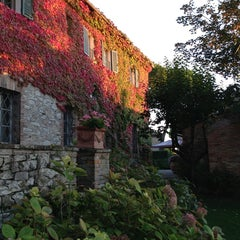 Photo taken at Borgo San Felice - Relais & Chateaux by Peter R. on 10/17/2013