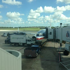 Photo taken at Gate 17 by Roxanne R. on 9/21/2013
