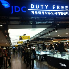 Photo taken at JDC Duty Free (JDC 면세점) by Lauren S. on 3/17/2013