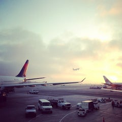 Photo taken at Gate 57 by Dai H. on 11/23/2012