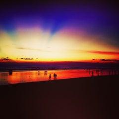 Photo taken at Pantai Kuta (Kuta Beach) by Belinda S. on 6/26/2013