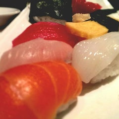 Photo taken at Sushi Samurai by Cecile D. on 12/24/2013