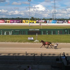 Photo taken at Scioto Downs Racino by Benjamin E. on 7/6/2013