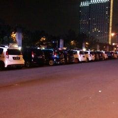 Photo taken at Patung Panahan Senayan by Albert S. on 8/1/2014