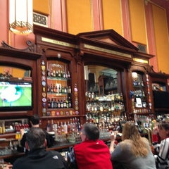 Photo taken at Ri Ra Irish Pub and Restaurant by Chris G. on 2/23/2013
