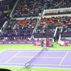 Photo taken at Khalifa International Tennis & Squash Complex by Dessa V. on 2/16/2013
