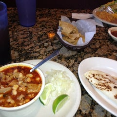 Photo taken at Tink-A-Taco Mexican Food & Cantina by Erika R. on 2/17/2013