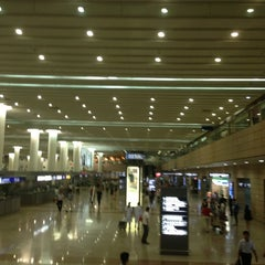 Photo taken at 上海浦东国际机场1号航站楼 T1 Shanghai Pudong Int'l Airport by Qiang Z. on 7/28/2013
