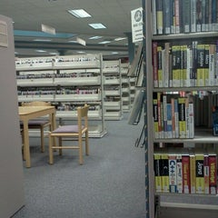 Photo taken at Regina Public Library - George Bothwell Library by Conrad H. on 10/31/2012