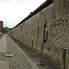 Photo taken at Baudenkmal Berliner Mauer   Berlin Wall Monument by Minnis T. on 4/23/2013