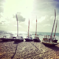 Photo taken at Praia do Pina by Carlos P. on 10/17/2012
