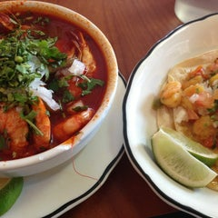 Photo taken at Tacos El Poblano by Jane S. on 4/7/2013