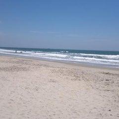 Photo taken at Praia de Itapoá by Alessandro R. on 1/25/2013