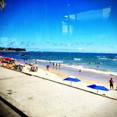 Photo taken at Praia de Itapuã by Guilherme #. on 12/24/2012