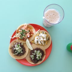 Photo taken at La Taqueria Pinche Taco Shop by Niña on 5/6/2013