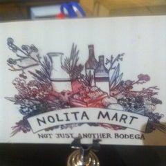 Photo taken at Nolita Mart & Espresso Bar by Igor K. on 11/12/2013