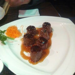 Photo taken at Big Tuna Sushi Restaurant by Monique J. on 1/17/2012
