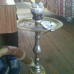 Photo taken at Saklı Bahçe Cafe&Nargile by Umut K. on 10/14/2012
