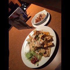 Photo taken at TGI Fridays by Danielle M. on 3/23/2014