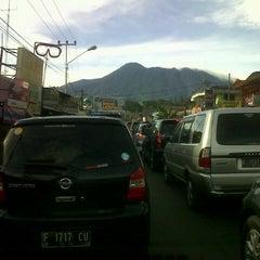 Photo taken at Jalan Raya Puncak by Dhani L. on 3/31/2013