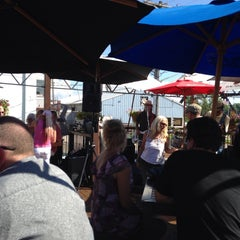 Photo taken at Muddy Waters Bar & Grill by Bill K. on 7/6/2014