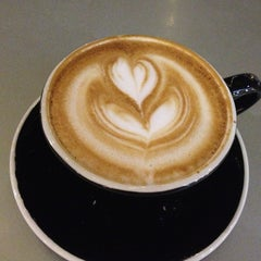Photo taken at Press Coffee Roasters by Chris T. on 1/23/2013