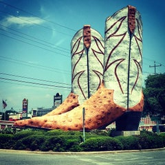Photo taken at World's Largest Cowboy Boots by Will O. on 4/28/2014