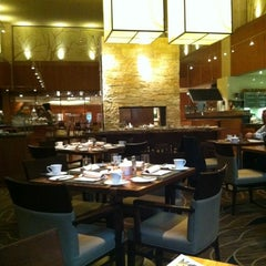 Photo taken at YEW seafood + bar by Irene V. on 10/18/2012