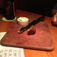 Photo taken at Outback Steakhouse by kim r. on 12/14/2012