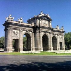 Photo taken at Puerta de Alcalá by Guero V. on 7/8/2013
